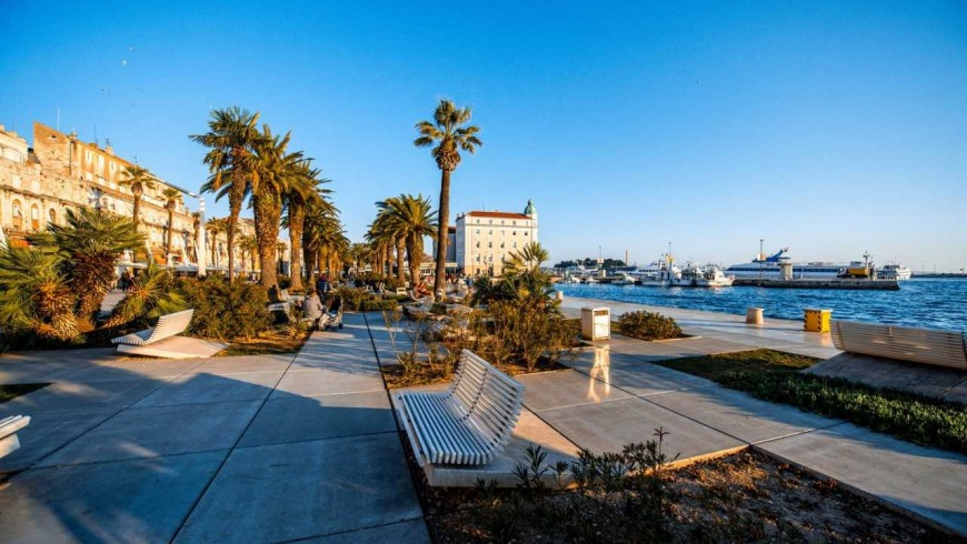 Riva promenade. A green walk surrounded by palms in Split