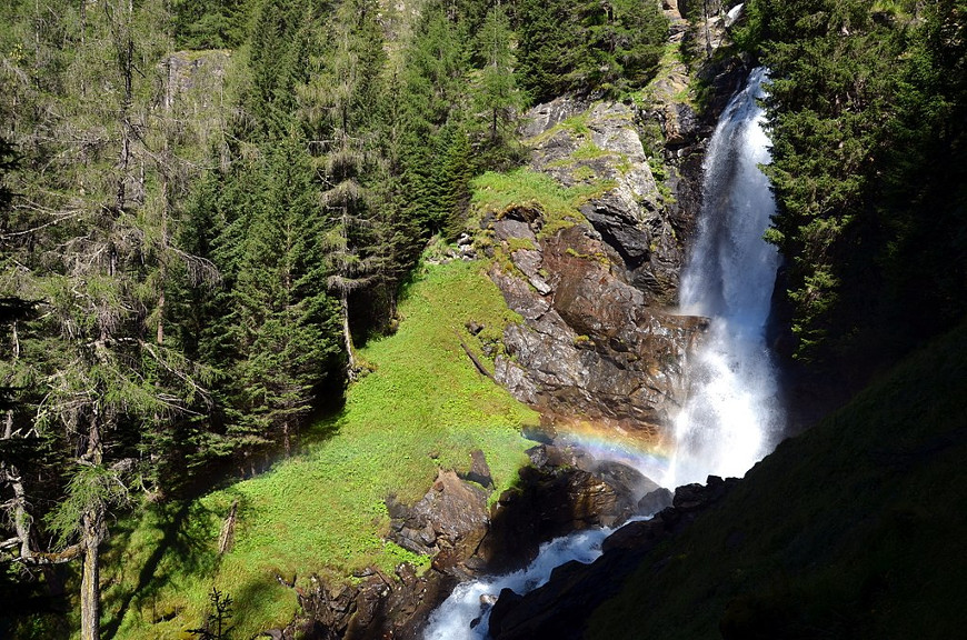 Amazing Saent Waterfall with rainbow, Rabbi Valley, Stelvio National Park