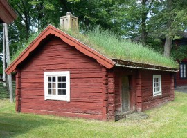 A red house with a grass roof