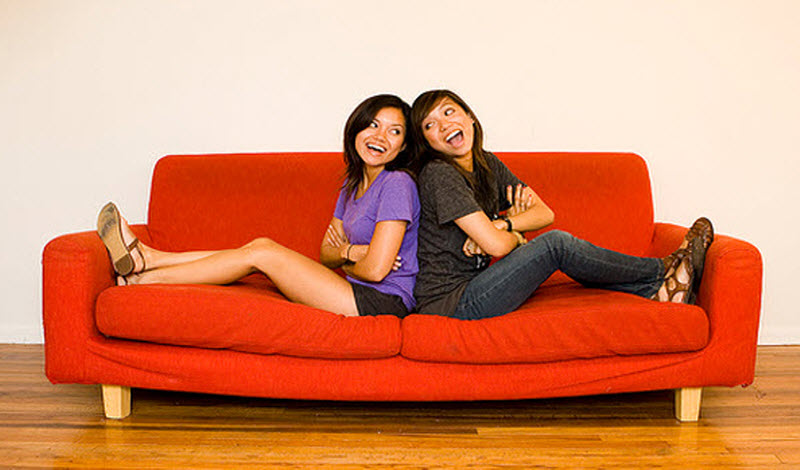 Two girls on a sofa
