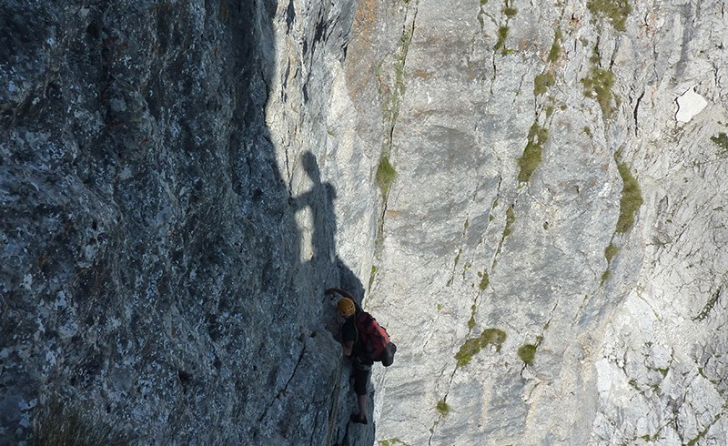 a guy is climbing on the rock