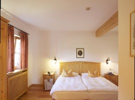 Pineta Hotels' room, a warm and cosy atmosphere