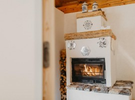 the fireplace of the eco-chalet in Trentino