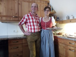 """A family inviting us in their farm during the """"Aufwart'n am Weissensee"""" festival"""