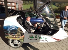 Peter Brandauer, mayor of Werfenwng, on board one of the many electric vehicles of the Alpine Pearl