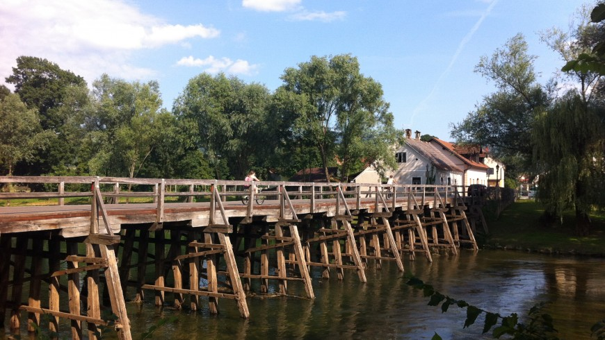 Kostanjevica na Krki, small wood bridge only for pedestrians to reach the historic old part of the town.