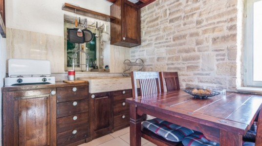 The wooden kitchen and the stone sink