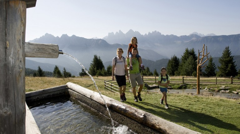 Family walking in a valley