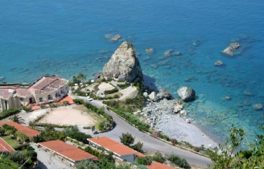 Aerial view on the village of Amantea, on the Tirreno Sea, with limpid water and a big rock near the coast