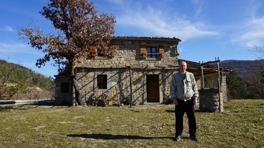 The owner in front of the house
