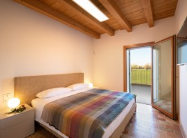 room with terrace and wide bed, natural sheets