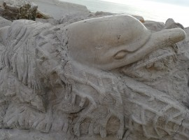 Dolphin carved on the cliff
