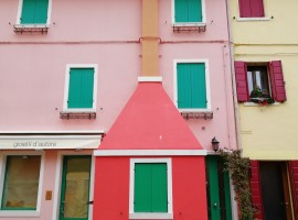 Pink, red and yellow houses with coloured windows
