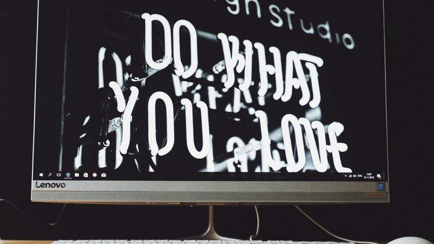 """pc screen says """"do what you love"""". Come up with the name of your travel blog"""