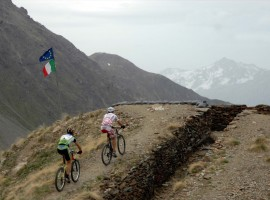 two cyclist on top of the mountain