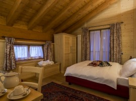 One of the rooms, furnished with wood and a king size bed