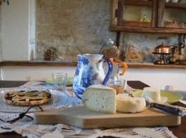 Table with breakfast, cheese and fresh milk