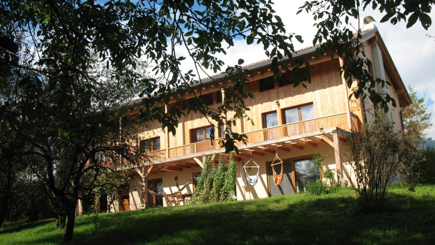The view of the outside part of the farmhouse, surrounded by unspoilt nature. Vegan cuisine in holiday