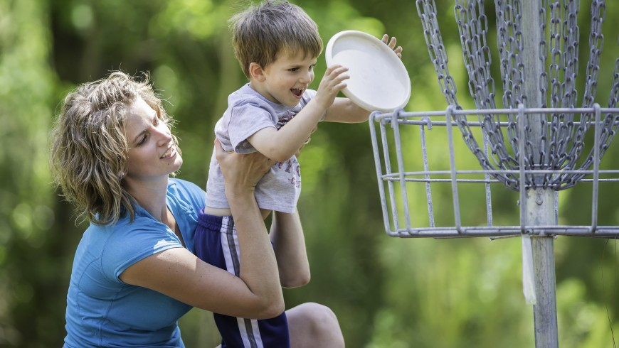 Cherie Knox helps her son Colton Knox as they play disc golf game at the new Bob Rodgers Memorial Disc Golf Course at Sam Houston Jones State Park near Lake Charles, La.