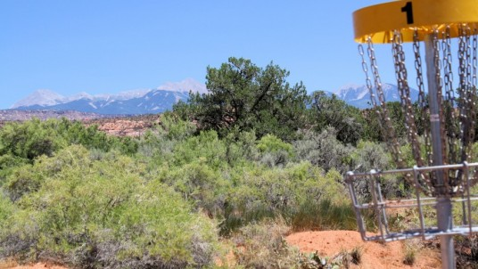 Disc golf field in the desert, surrounded by wild nature