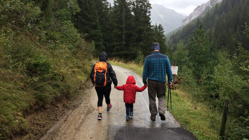 A family hiking on a mountain road