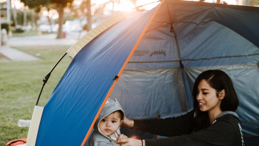 A woman enjoying one of the best sustainable trips for families with her kid